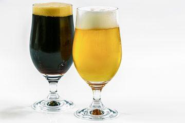 A dark beer and a light beer, in stemmed glasses