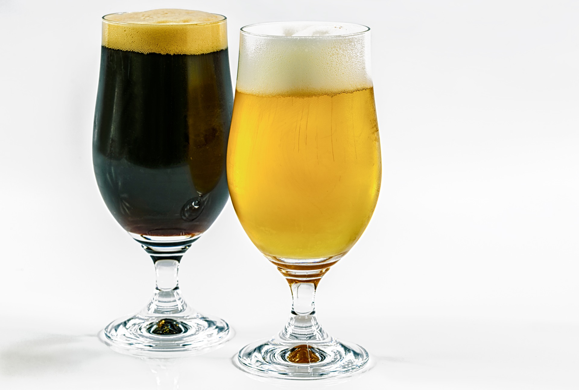 A dark beer and a light beer, in stemmed glasses