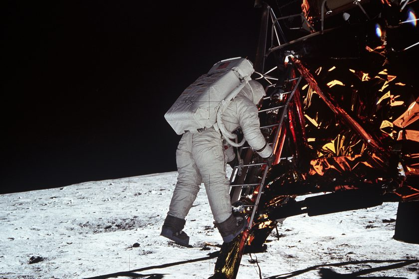 Buzz Aldrin descends the steps of the lunar module ladder as he prepares to walk on the moon