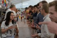 Bar staff and customers at a beer festival