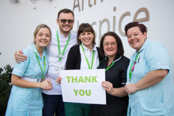Arthur Rank Hospice staff holding a thank you sign