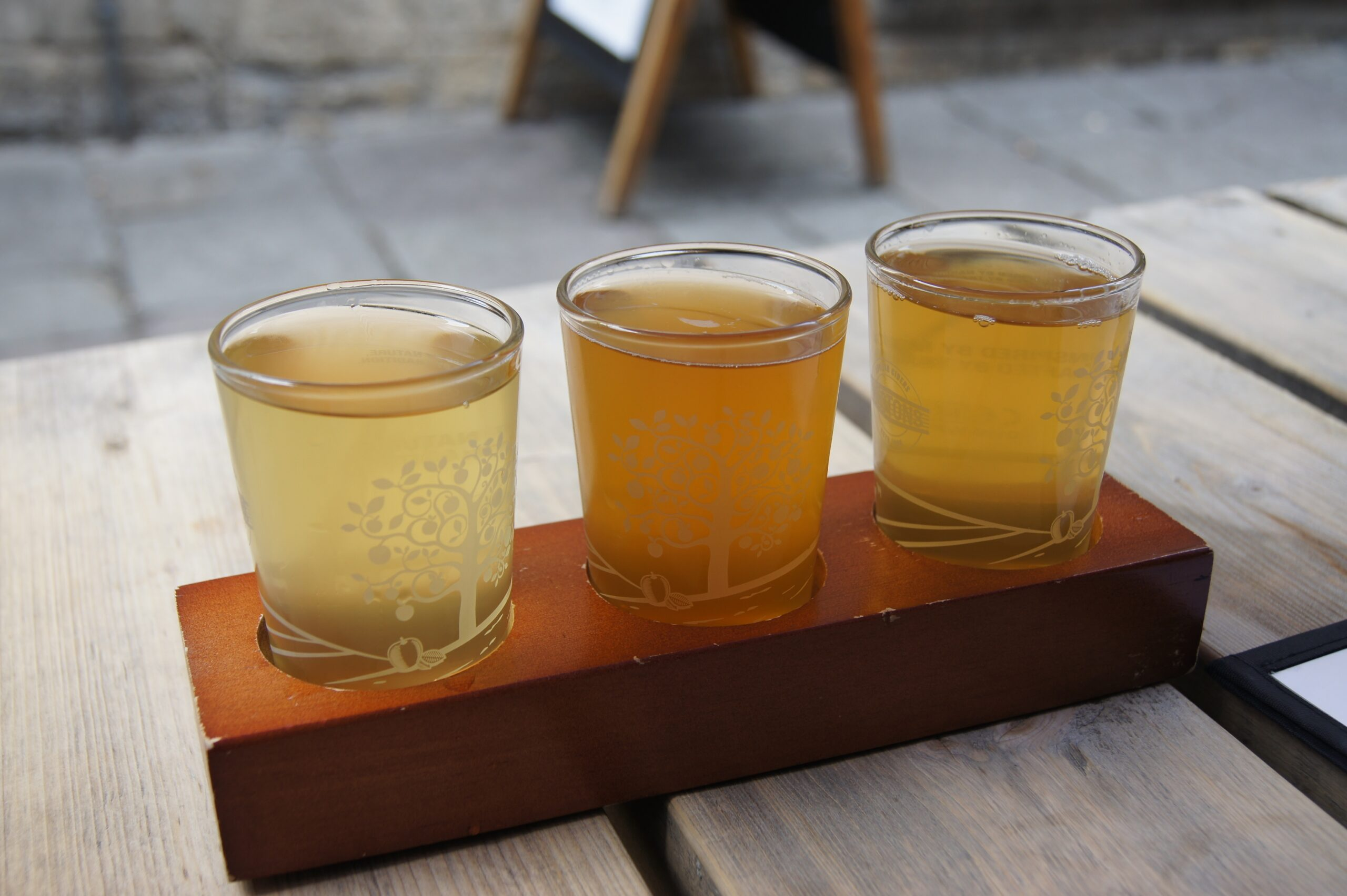 cider in glasses on a table
